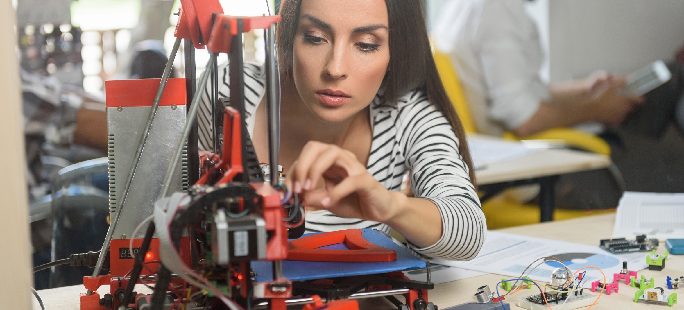 Professional female engineer working with 3d printing